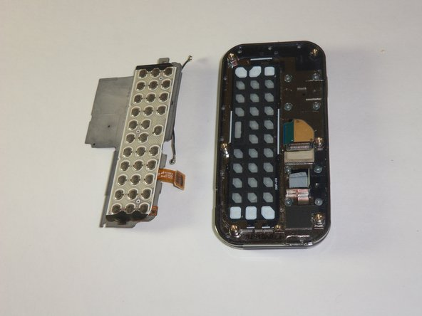 The keyboard chip is located on top of the device. Pry the keyboard off of the case with  the plastic opening tool.