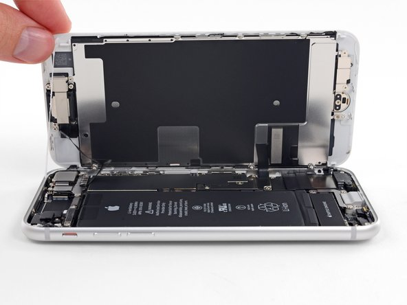 Don't try to fully separate the display yet, as several fragile ribbon cables still connect it to the iPhone's logic board.