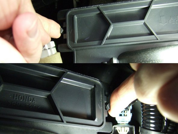 The air filter tray is held in by two locking tabs on the front left and front right. Reach in and press these tabs in towards the center.