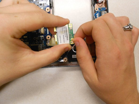 Disconnect the wires on the WiFi card. This can be done easily by applying pressure to the connections until they pop off of the card.