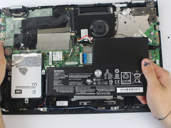 Pull the battery outward and remove it from the rest of the laptop.