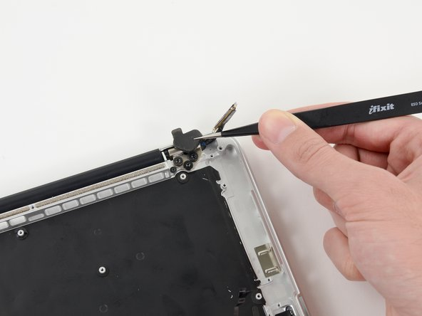 Image 1/2: Use a pair of tweezers to lift the rubber hinge covers up off the right and left display hinges.