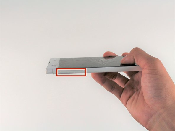 Wedge your finger under the bottom ridge of the SD card insert.