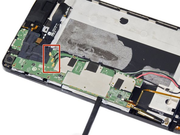 Use a pair of tweezers to disconnect the three black antenna cables from the motherboard.