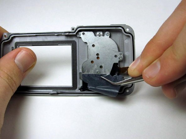 Peel back the black sticky film on the right side to reveal six screws.