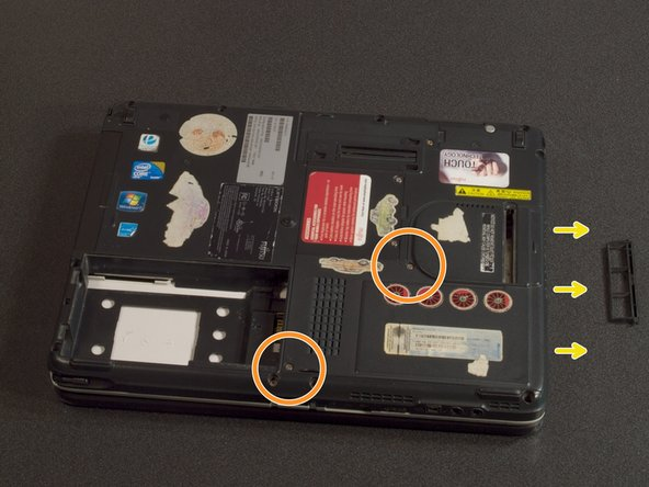 Image 2/3: Slide the hard drive cove to the right and lift it free.
