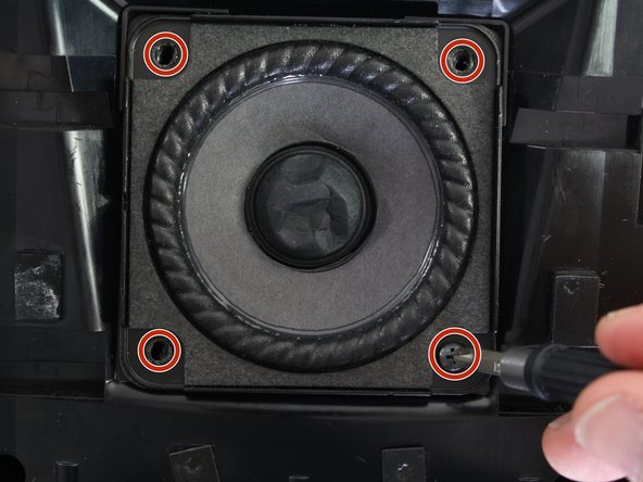 Use a #2 Phillips screwdriver to remove each of the  four 15mm screws holding the speaker in place.