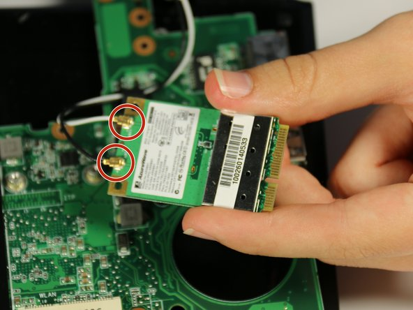 Image 1/3: Lift the connections away from the wireless network card.