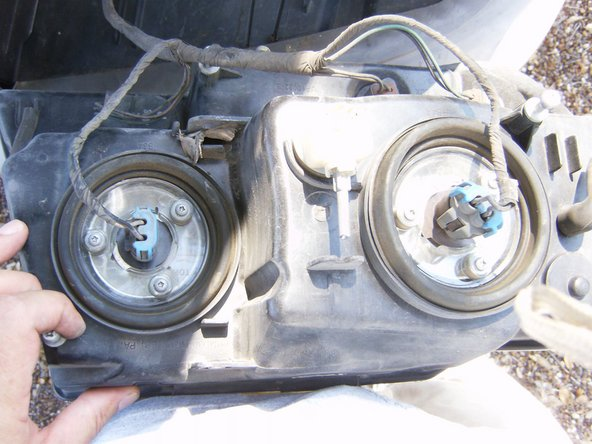 Image 3/3: Remove all bulb sockets from headlamp module. Separate headlamp from vehicle.