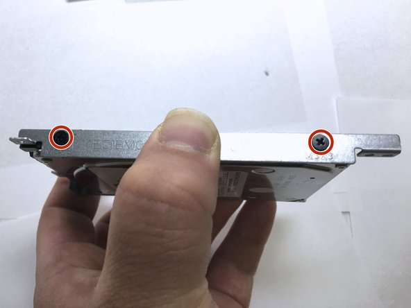 Remove bracket screws from the hard drive.