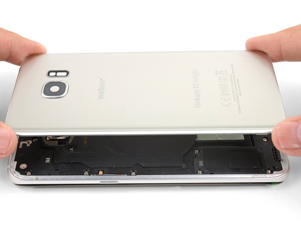To seal the phone, align and set the back cover onto the phone frame.