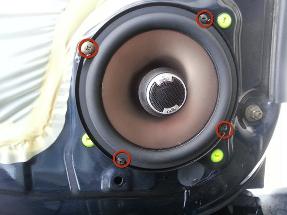 Remove the four screws holding the front door speaker in.