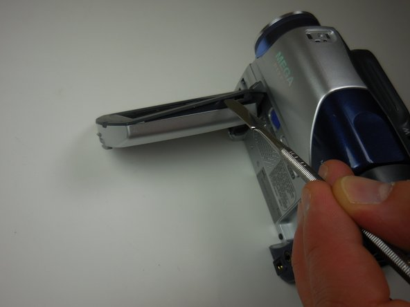 Pry apart the plastic casing around the screen using a flat spudger tool