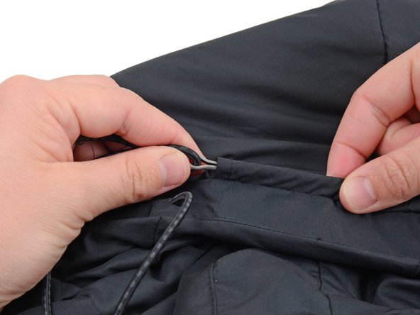 The casing will vary on each garment. In this case the drawstring casing is visible on the exterior of the garment, but it may be on the inside of your garment.