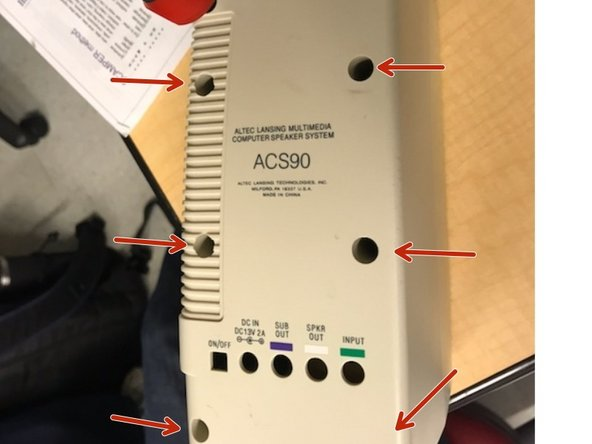 """Use a medium sized Phillips-head screwdriver that is at least 6"""" or longer in length to the unscrew 6 screws holding the speaker together"""