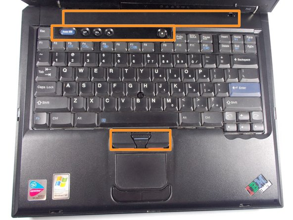 Take the spudger tool,  go around the edges of the oranges boxes shown, and pop off those two sections. Then, go around the edges of the keyboard, and it should slide off.