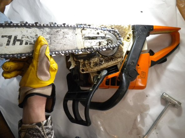 Image 1/1: Pull the chain back to loosen off of the gears, and lift straight up.