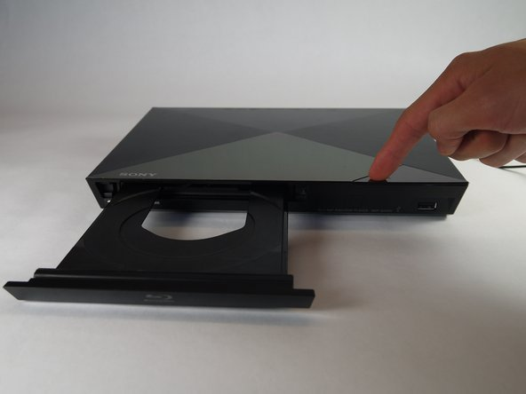 Plug in the Blu-Ray player, then press the power button, making sure the Blu-Ray player is powered on.