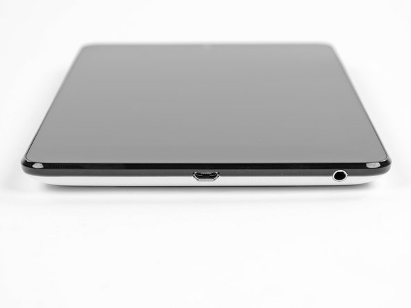 Image 1/1: The only ports on the exterior of the Nexus 7 lie on its lower edge. Sorry port junkies, micro USB and 3.5 mm audio are the only gateways you'll find here.