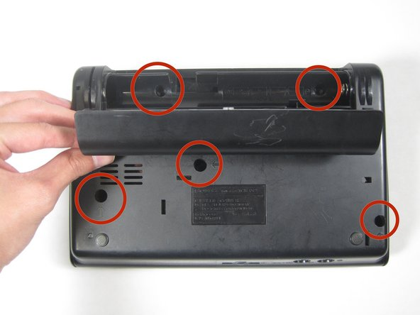 Remove the 5, 5.95mm screws as indicated in the picture using the Phillips head screwdriver.