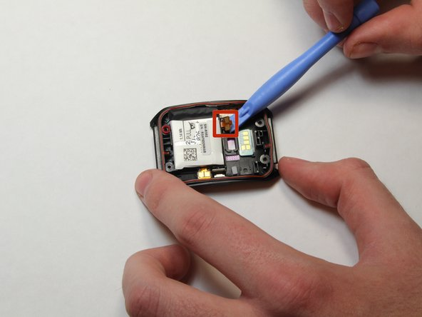 Image 1/1: Using the plastic opening tool, gently pry the contacts away from the plastic channel in which they fit.