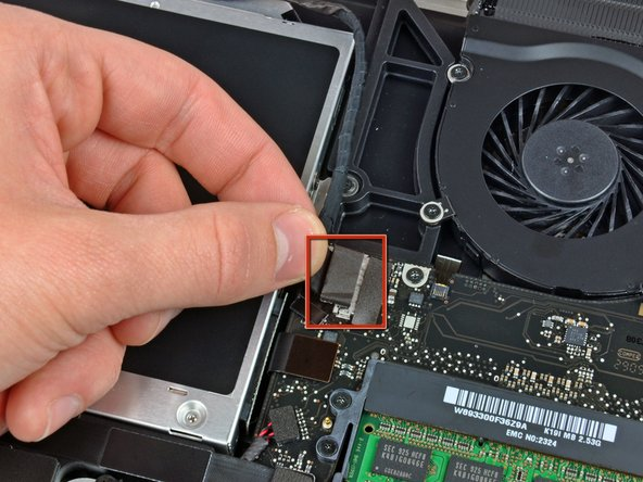 Disconnect the camera cable by pulling the male end straight away from its socket.