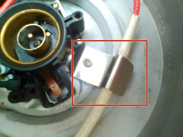 Image 1/3: Remove the screw, a standard number 2 phillips head.