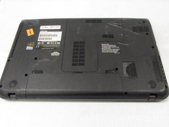 Power down the laptop and remove all power cords. After this is done, turn the laptop over.