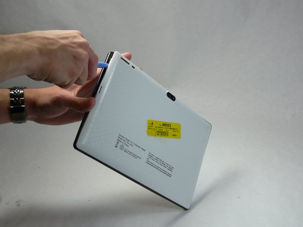 Take plastic opening tools, and find a spot on the back of tablet to lift the back plate. Once back is lifted enough, remove the back of the tablet carefully with fingers
