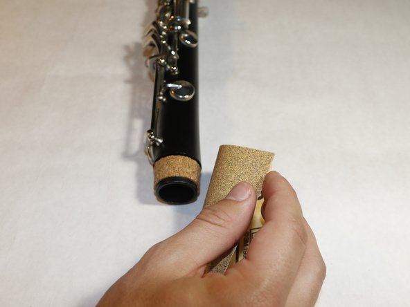 Sand the cork with sandpaper until the cork is smooth.