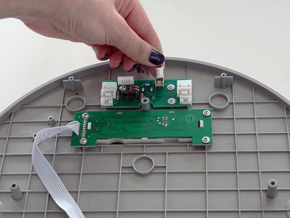 Attach the new dock sensor to the circuit board.