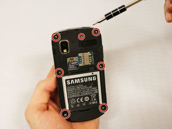 Using the PH000 screwdriver, remove the 7 screws in the back of the device.