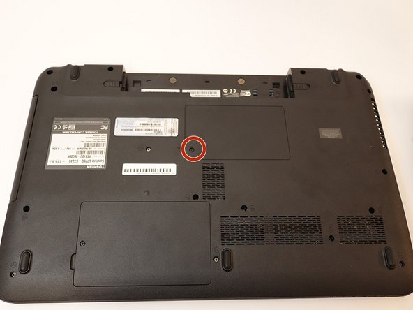 Use the Phillips #1 screwdriver to remove the one 4.6 mm screw holding on the cover located on the bottom center of the laptop.
