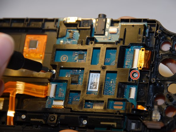 First you will want to remove the black casing holding the motherboard in.