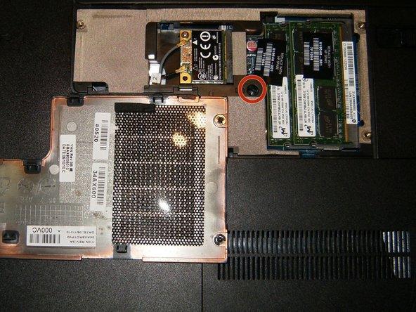 Image 2/2: Remove the memory module compartment cover, remove the Phillips M2.5X5.0 screw