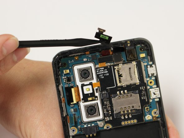 Using a spudger or plastic opening tool, gently disconnect the ribbon cable attached to the black SIM card board.