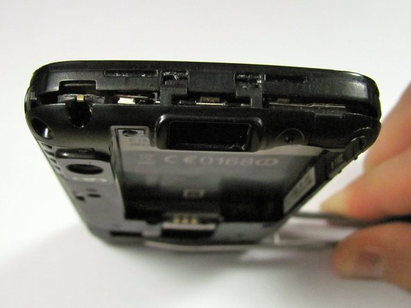 Image 2/2: After separating the sides, make sure there is a noticeable gap between the back case and the rest of the phone.