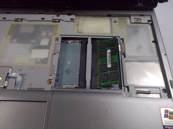 After removing the second metal covering you will remove the RAM compartment.
