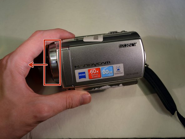 Lay the device on it's left side, with the front lens facing left (first photo).