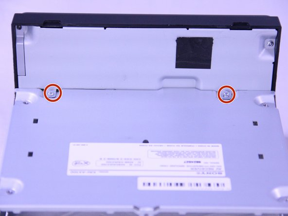Remove two 3.5mm Phillips #0 screws from the back of the head unit.