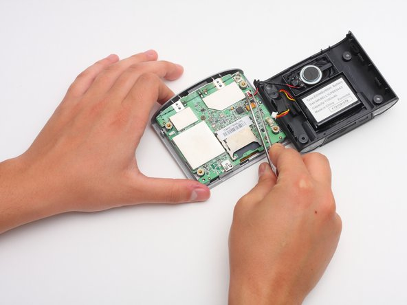 Once the two covers are separated, use tweezers, or even your fingers, to gently disconnect the two sets of wires that are connected to the motherboard from the back cover.