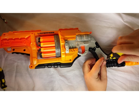 Carefully reassemble the Nerf Law bringer in the same order you took it apart. Carefully reattach the 3 screws that seal the air chamber.