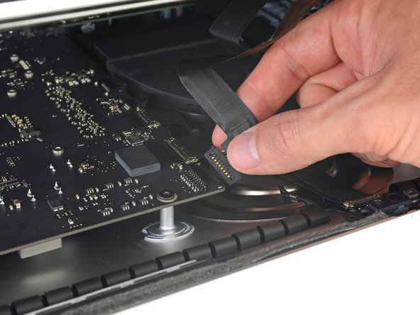 At this point it's a good idea to test your repair, in order to make sure your iMac works properly before you seal it back up. Follow the next three steps to temporarily reconnect the display cables and boot up your iMac prior to pulling the protective film off the adhesive strips.