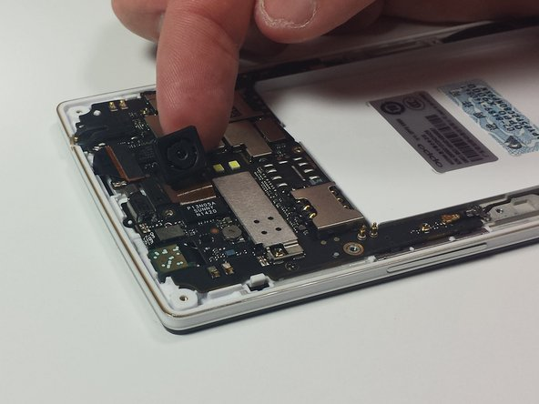 Use your fingers to pull the camera straight up from the motherboard to fully detach the camera.