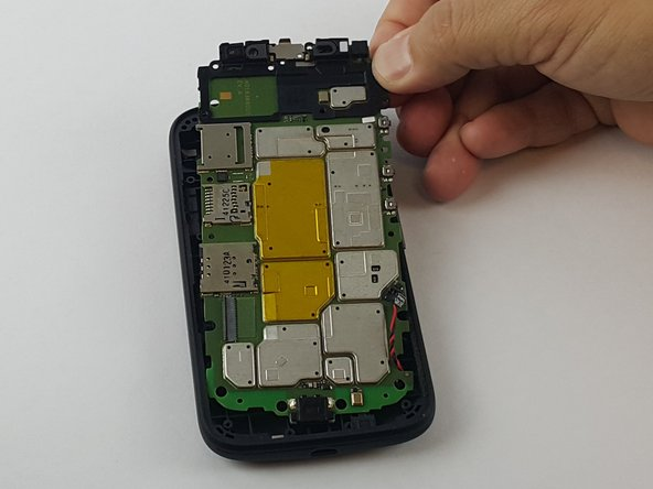 Now just pull the motherboard starting from the top to bottom off the phone case.