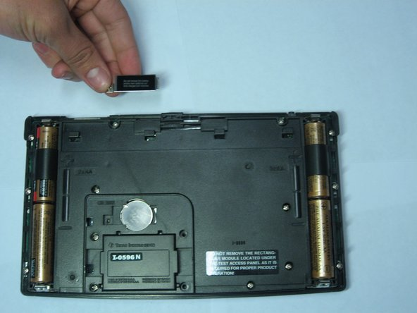 Remove the metal cover keeping the backup battery in place.