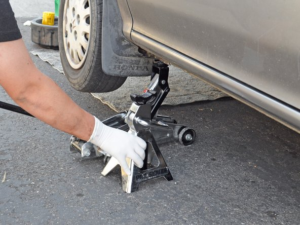 Remove the jack stand from under the car.