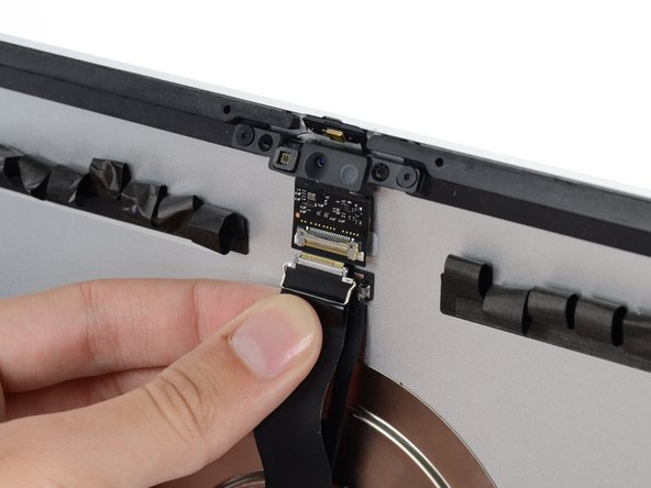 Be sure to remove only the iSight connector—the microphone connector is on a separate branch of the cable.
