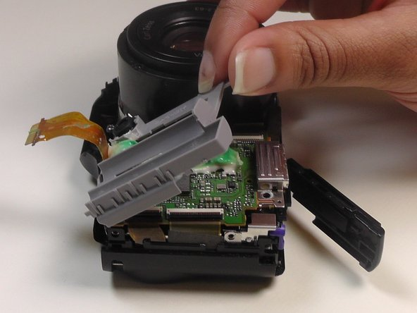 Lift up the gray plastic facing in order to uncover the motherboard and the ribbon cable ports.