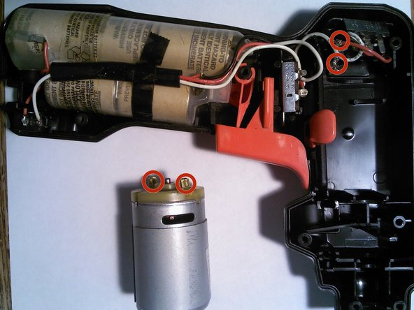 Pull out the motor and lay it next to the drill; keep in mind that the white and red wires will still be attached to the motor.